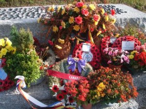 Wreaths from allied nations in the German cemetery.